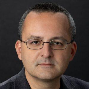 A headshot of Alberto Cairo
